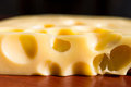 Cheese piece of with holes closeup Stock Photography