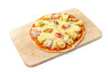 Cheese pizza on wooden plate, isolated background Royalty Free Stock Photo