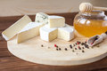 Cheese plate with Brie, Camembert, Roquefort Royalty Free Stock Photo
