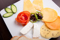 Cheese plate and olive tomato platter with vegetable and herbs Royalty Free Stock Photo