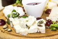 Cheese plate with several kinds of on a white background Royalty Free Stock Photos