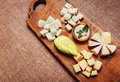 Cheese platter garnished with honey and apple Royalty Free Stock Photo