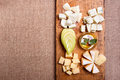 Cheese platter garnished with honey, apple and spice Royalty Free Stock Photo