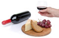 Cheese and red wine with a hand holding a glass isolated on white Royalty Free Stock Photos