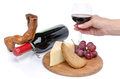 Cheese and red wine with a hand holding a glass isolated on white Royalty Free Stock Photo