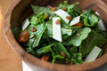 Cheese salad contained in a wooden bowl Royalty Free Stock Photography