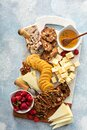 Cheese and snacks board with raspberry and crackers Royalty Free Stock Photo