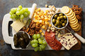 Cheese and snacks platter overhead shot Royalty Free Stock Photo