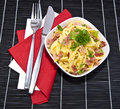 Cheese Spaetzle with cutlery (on black) Royalty Free Stock Images