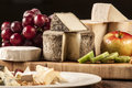 Cheese specialties on wood plate. Royalty Free Stock Photo