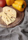 Cheese and tomatoes on the wood plank Royalty Free Stock Photo
