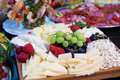 Cheese tray closeup of a with fruits Royalty Free Stock Photos