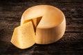 Cheese wheel on wood. Organic food Royalty Free Stock Photo