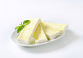Cheese with white rind plate of sliced soft on background Stock Photo
