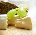 Cheese with wine and bread food background Stock Photos