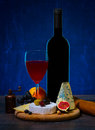 Cheese and wine composition with various types of fruits on wooden table Stock Photos