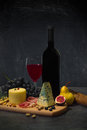 Cheese and wine composition with various types of fruits on wooden table Royalty Free Stock Photos