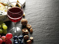 Cheese with wine glass and fruits. Royalty Free Stock Photo