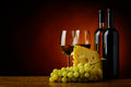 Cheese wine and grapes still life with red white Royalty Free Stock Photo