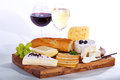Cheese with wine served on wooden plate Stock Image