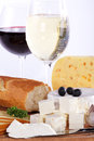 Cheese with wine served on wooden plate Stock Photo