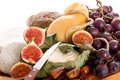 Cheeseboard  with cheese and fruits Stock Images