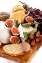 Cheeseboard  with cheese and fruits Royalty Free Stock Photos