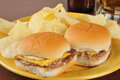 Cheeseburger sliders with potato chips and beer Royalty Free Stock Image