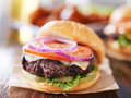 Cheeseburgers with wings and beer Royalty Free Stock Photo