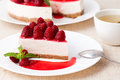 Cheesecake with berry sauce and green tea Royalty Free Stock Photography