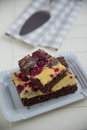 Cheesecake brownies with raspberry home made Stock Photography