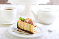 Cheesecake with caramel drizzle served on plate Royalty Free Stock Photography