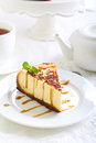 Cheesecake with caramel drizzle served on plate Stock Images