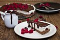 Cheesecake with chocolate and raspberries unbaked on a wooden table Royalty Free Stock Photos