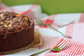 Cheesecake with chocolate shortcrust pastry and chocolate crumble arranged on a wooden board Royalty Free Stock Photos