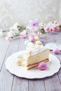 Cheesecake with coconut for easter and candy on a plate Stock Photography