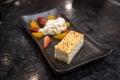 Cheesecake with orange and strawberry whip cream