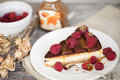 Cheesecake with raspberry and chocolate a delicious piece of raspberries on white plate flowers Stock Photo