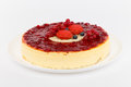 Cheesecake with red currants in a plate on a white background Stock Images