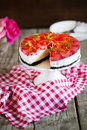 Cheesecake with strawberries in gelatine and herbs, on oreo cookies Royalty Free Stock Photo