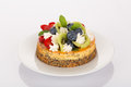 Cheesecake strawberry blueberry and kiwi with cream on white plate Royalty Free Stock Image