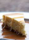 Cheesecake thick slice of with caramel and white chocolate drizzle Stock Photo