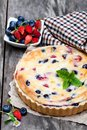 Cheesecake  with wild forest berries. Summer  dessert Royalty Free Stock Photo