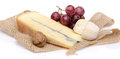 Cheeses and grapes on a burlap isolated white Stock Photos