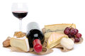 Cheeses wine and grapes on a burlap isolated white Royalty Free Stock Photography