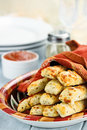 Cheesy asiago breadsticks and dip fresh golden with marinara sauce parmesan cheese in background shallow depth of field Royalty Free Stock Photos