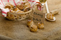 Cheesy bites with seeds wine in wicker basket nice gift Royalty Free Stock Photos