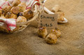 Cheesy bites with seeds wine in wicker basket nice gift Royalty Free Stock Image