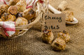 Cheesy bites with seeds wine in wicker basket nice gift Stock Photos