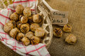 Cheesy bites with seeds wine in wicker basket nice gift Royalty Free Stock Photography